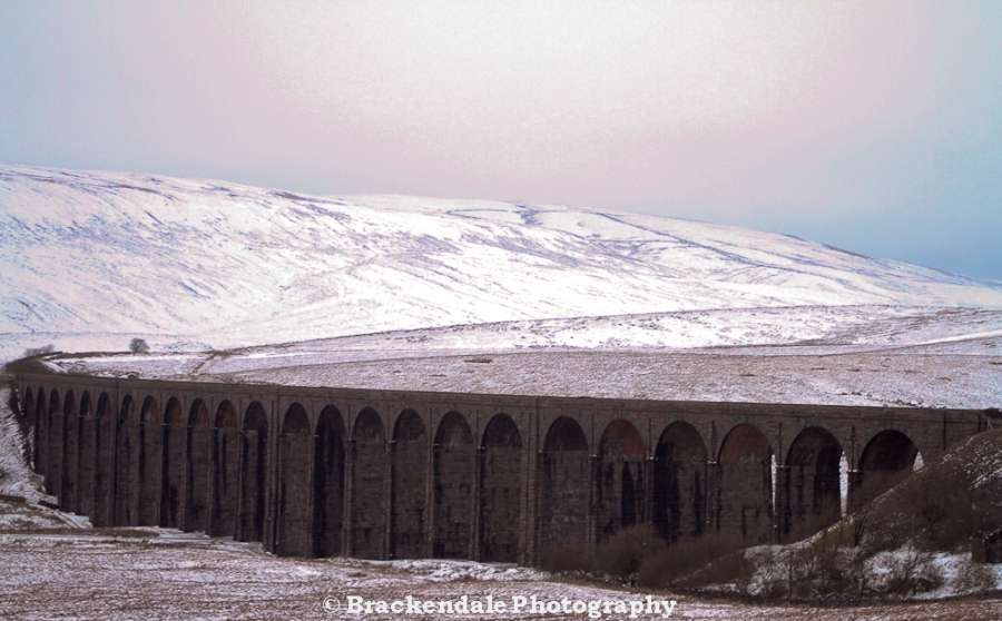 Snowy Whernside with Ribbleshead Viaduct